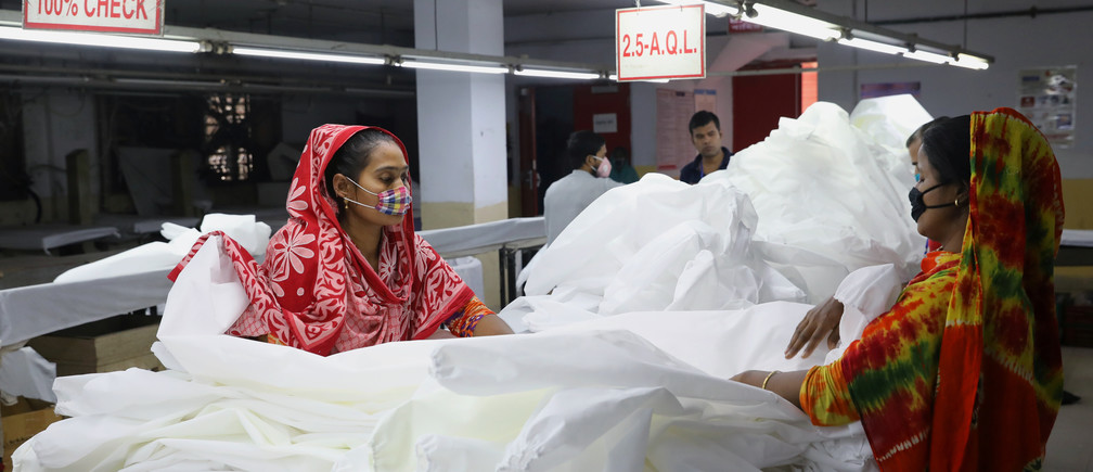 Bangladeshi garment workers make protective suit at a factory amid concerns over the spread of the coronavirus disease (COVID-19) in Dhaka, Bangladesh, March 31, 2020. REUTERS/Mohammad Ponir Hossain - RC21VF9UDQ8E