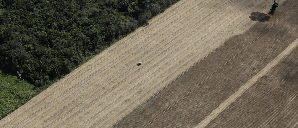 A tractor works on a wheat plantation on land that used to be virgin Amazon rainforest near the city of Santarem, Para State, April 20, 2013
