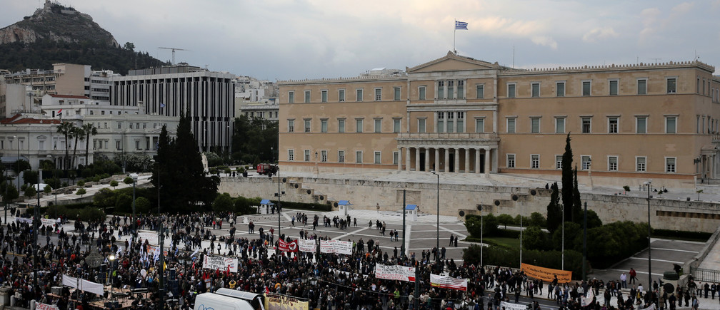Demonstrators are gathered outside the parliament building as Greek lawmakers vote on the latest round of austerity Greece has agreed with its lenders, in Athens, Greece, May 18, 2017. REUTERS/Alkis Konstantinidis - RTX36G7E