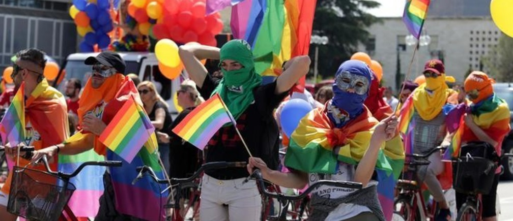 LGBT rights activists react during the Tirana Gay (P)Ride in Tirana Albania May 13, 2018.