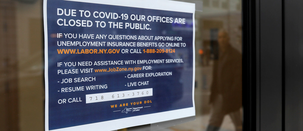 Signage is seen posted on the entrance of the New York State Department of Labor offices, which closed to the public due to the coronavirus disease (COVID-19) outbreak in the Brooklyn borough of New York City, U.S., March 20, 2020. REUTERS/Andrew Kelly - RC2TNF9JT4Y7