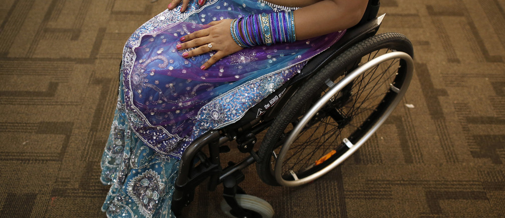 A competitor waits backstage during Miss Wheelchair India, the country's first wheelchair beauty pageant, in Mumbai November 24, 2013. A total of 16 women from all across the India participated in the contest. The organisers hope the pageant will open doors for differently-abled women in the fields of modeling, film, and television.  REUTERS/Danish Siddiqui (INDIA - Tags: SOCIETY) - GM1E9BP0ABZ01