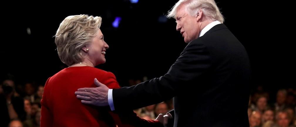 Republican U.S. presidential nominee Donald Trump shakes hands with Democratic U.S. presidential nominee Hillary Clinton at the start of their first presidential debate at Hofstra University in Hempstead, New York, U.S., September 26, 2016.
