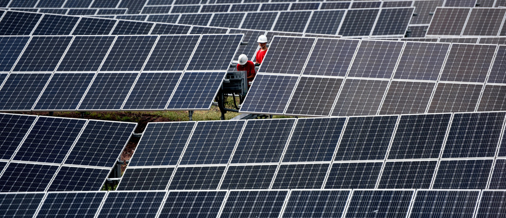 Workers inspect solar panels at a photovoltaic power station on a hill in Linyi, Shandong province, China August 11, 2018. Picture taken August 11, 2018. REUTERS/Stringer  ATTENTION EDITORS - THIS IMAGE WAS PROVIDED BY A THIRD PARTY. CHINA OUT.      TPX IMAGES OF THE DAY - RC1B356A26B0