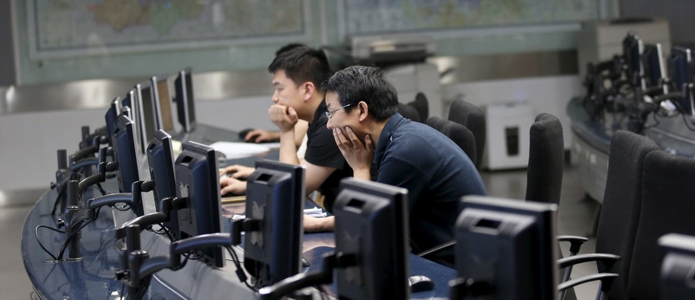 Staff members of the Beijing Municipal Environmental Protection Monitoring Center work in a monitoring room of the air quality forecast and warning center in Beijing, China, May 21, 2015.