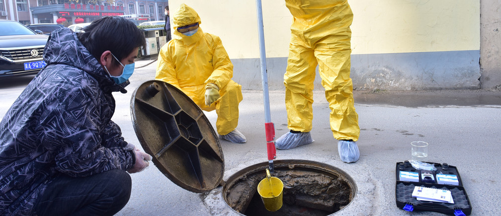 Workers of the ecology and environment bureau collect samples from the sewage system of a hospital following an outbreak of the novel coronavirus in the country, in Xinle, Hebei province, China February 8, 2020. Picture taken February 8, 2020