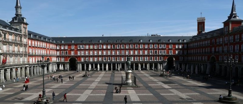 General view of the famous landmark Plaza Mayor square with unusually few people visiting due to the coronavirus outbreak in central Madrid, Spain, March 13, 2020. REUTERS/Sergio Perez - RC22JF9EC375