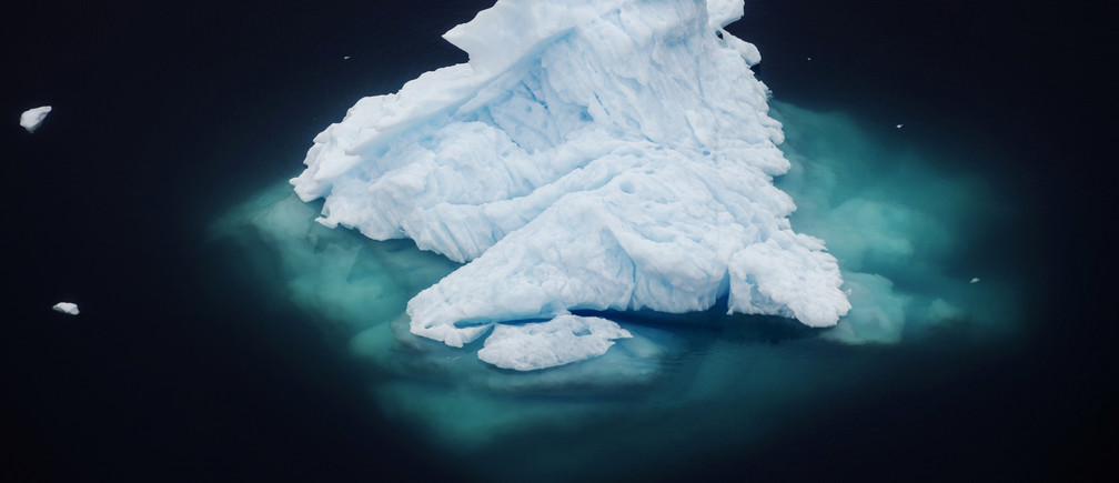 """An iceberg floats in a fjord near the town of Tasiilaq, Greenland, June 24, 2018. REUTERS/Lucas Jackson  SEARCH """"JACKSON GREENLAND"""" FOR THIS STORY. SEARCH """"WIDER IMAGE"""" FOR ALL STORIES.    TPX IMAGES OF THE DAY - RC1FDC4B6C60"""