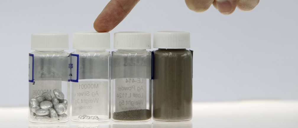 A Cima NanoTech employee introduces the raw materials used to manufacture the patented SANTE Technology silver dispersion in their lab in Singapore April 12, 2013. From left the materials are aluminium, silver, coarse silver nanopowder and fine silver nanopowder.