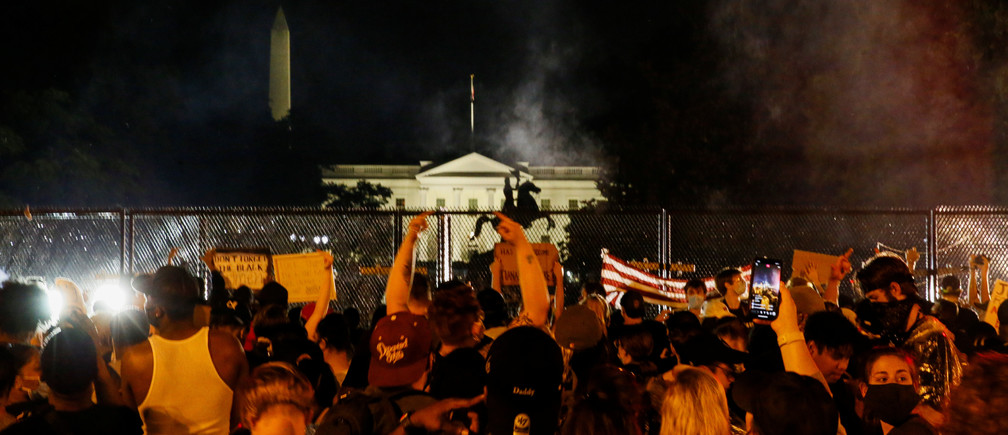 Demonstrators gather behind a fence during a protest against the death in Minneapolis police custody of George Floyd, in Lafayette Park in front of the White House, in Washington, U.S., June 4, 2020.