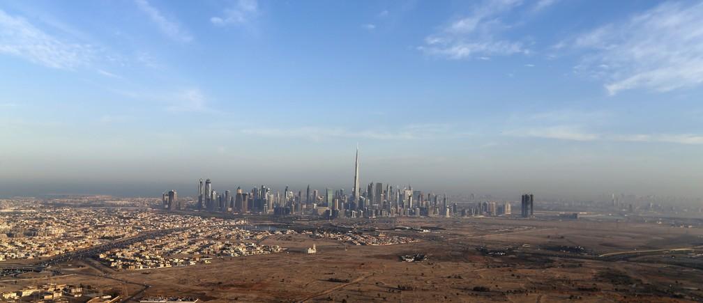 Burj Khalifa, the world's tallest tower, is seen in a general view of Dubai, UAE December 9, 2015. Picture taken December 9, 2015. REUTERS/Karim Sahib/Pool - RTX1Y3QE
