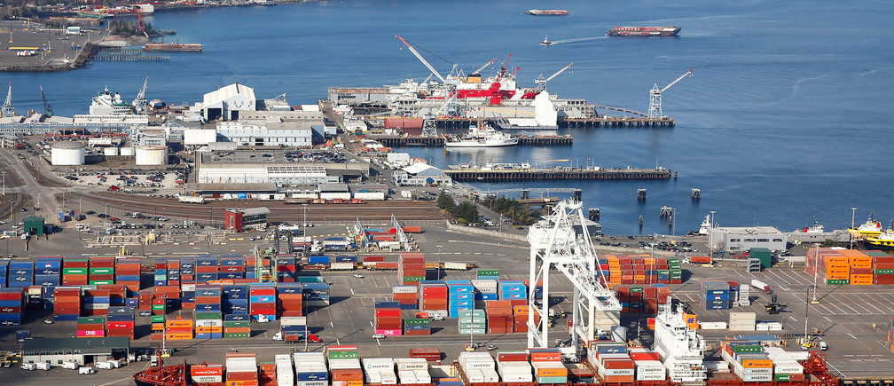 An aerial photo shows the Seoul Express container ship, registered in Germany, docked at Harbor Island at the Port of Seattle in Seattle, Washington, U.S. March 21, 2019. Picture taken March 21, 2019.   REUTERS/Lindsey Wasson - RC14E5B326C0