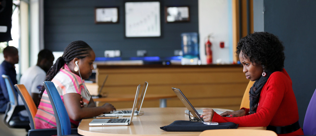Entrepreneurs work on their projects at Nailab, a Kenyan firm that supports technology startups, behind the latest initiative, which targets entrepreneurs for their ideas on providing sex education through technology and social media in Nairobi, Kenya, July 4, 2016. REUTERS/Thomas Mukoya - RTX2JKNZ