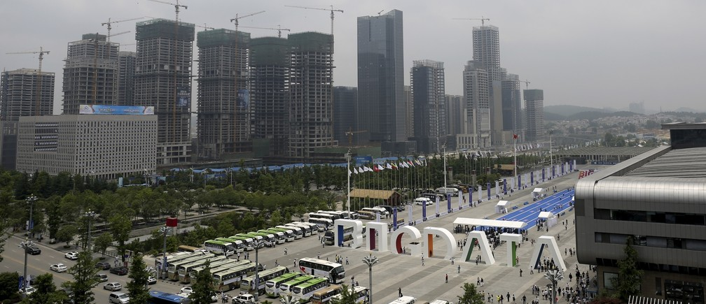 """A big sign of """"Big Data"""" is seen outside the venue of the 2015 Big Data Expo, near residential buildings under construction, in Guiyang, Guizhou province, China, May 26, 2015. Picture taken May 26, 2015."""