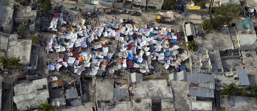 A group of tents stands amidst the rubble after an earthquake in Port-au-Prince, in this United Nations handout taken January 12, 2010. The number of U.N. military and police officials confirmed to have been killed in the Haiti earthquake now stands at 22, U.N. Secretary-General Ban Ki-moon said on Thursday. Picture taken January 12. REUTERS/UN Photo Logan Abassi/Handout   (HAITI ENVIRONMENT - Tags: DISASTER POLITICS IMAGES OF THE DAY) ENVIRONMENT) FOR EDITORIAL USE ONLY. NOT FOR SALE FOR MARKETING OR ADVERTISING CAMPAIGNS - GM1E61F02PZ01