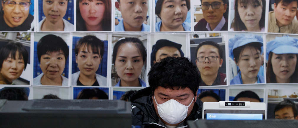 A software engineer works on a facial recognition program that identifies people when they wear a face mask at the development lab of the Chinese electronics manufacturer Hanwang (Hanvon) Technology in Beijing as the country is hit by an outbreak of the novel coronavirus (COVID-19), China, March 6, 2020. Picture taken March 6, 2020.  REUTERS/Thomas Peter - RC28GF92J6MD