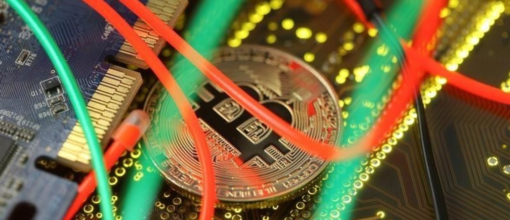 Representation of the Bitcoin virtual currency standing on the PC motherboard is seen in this illustration picture, February 3, 2018. REUTERS/Dado Ruvic/Illustration - RC1E9F62BA00