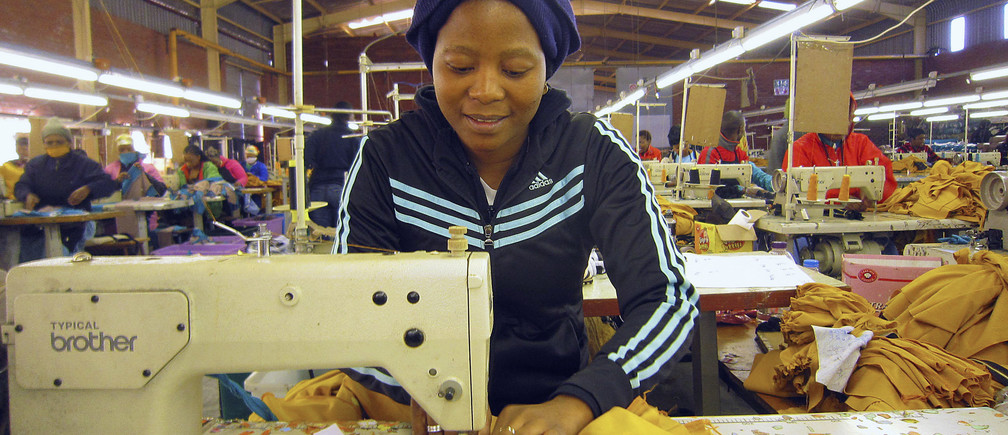 A woman works at a clothing factory at the industrial town of Newcastle, 260 km (162 miles) southeast of Johannesburg May 8, 2013.