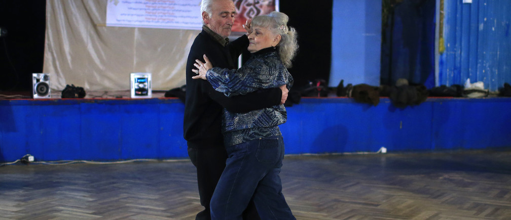 Tsira Tsagareli (R), 66, dances with Jemal Nemsitsveridze, 77, during a class at the Fortune dance club in Tbilisi January 29, 2015. Eliso Bakuradze, 79, who has been dancing since her school years, established the club 10 years ago. About 20 people, mostly pensioners, gather at the club three times a week to enjoy dancing. REUTERS/David Mdzinarishvili (GEORGIA - Tags: SOCIETY) - GM1EB1U06M601