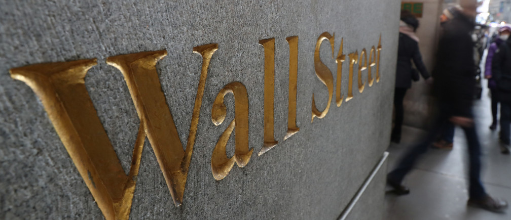 A street sign, Wall Street, is seen outside New York Stock Exchange (NYSE) in New York City, New York, U.S., January 3, 2019. REUTERS/Shannon Stapleton - RC1C326C6140