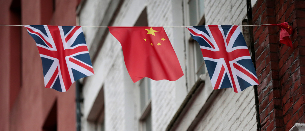 FILE PHOTO - Chinese and British flags fly in London's Chinatown, Britain October 19, 2015. REUTERS/Suzanne Plunkett/File Photo - RTX2I3SF