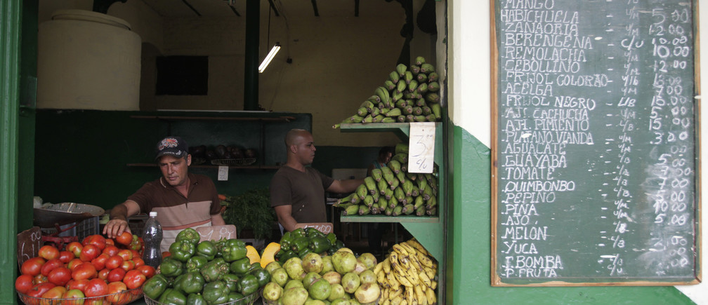 Vendors arrange produce at a farmers' market in Havana January 15, 2015.