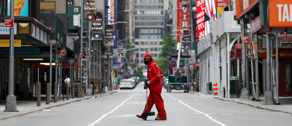 A street cleaner walks through the closed Broadway theatre district near Times Square following the outbreak of the coronavirus disease (COVID-19) in Manhattan, New York City, U.S., May 24, 2020. REUTERS/Andrew Kelly