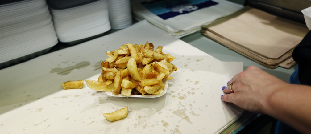 A portion of chips flavoured with vinegar are seen at Mr Fish restaurant in north London May 22, 2012. Deep-fried fish in a crispy batter with fat golden chips is still as popular as ever with the British public, ranked alongside roast beef and Yorkshire pudding and chicken tikka masala as the nation's favourite dish.   Picture taken May 22, 2012. REUTERS/Eddie Keogh (BRITAIN - Tags: FOOD SOCIETY) ATTENTION EDITORS: PICTURE 05 OF 29 FOR PACKAGE 'AS BRITISH AS FISH AND CHIPS'.SEARCH 'EDDIE FISH' TO FIND ALL IMAGES - GM1E8671H0Z01