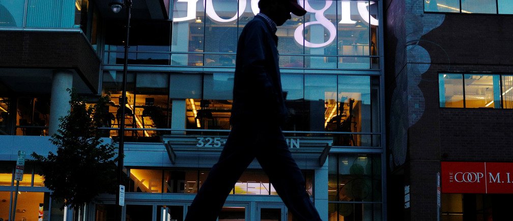 A pedestrian walks past the Google offices in Cambridge, Massachusetts, U.S., June 27, 2017.  This logo has been updated and is no longer in use. REUTERS/Brian Snyder - RC19229EBB50