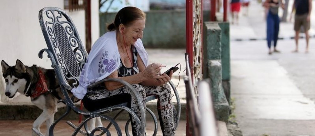 Yudaris Aleman speaks to her daughter who lives in Canada, via a mobile device in Varadero, Cuba, December 6, 2018. Picture taken on December 6, 2018. REUTERS/Fernando Medina - RC1E48A271D0