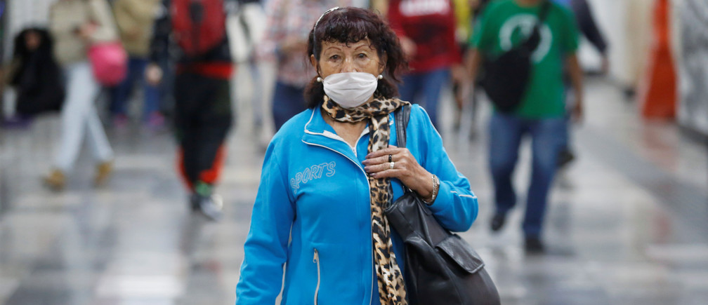 A commuter wearing surgical mask walks inside metro installations as the coronavirus disease (COVID-19) outbreak continues, in Mexico City, Mexico March 24, 2020.