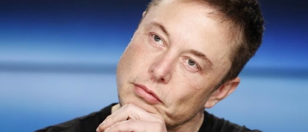 SpaceX founder Elon Musk listens at a press conference following the first launch of a SpaceX Falcon Heavy rocket at the Kennedy Space Center in Cape Canaveral, Florida, U.S., February 6, 2018. REUTERS/Joe Skipper