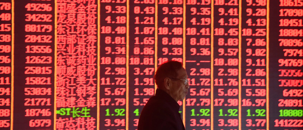 A man is seen in front of an electronic board showing stock information on the first day of trading in the Year of the Pig, following the Chinese Lunar New Year holiday, at a brokerage house in Hangzhou, Zhejiang province, China February 11, 2019. REUTERS/Stringer  ATTENTION EDITORS - THIS IMAGE WAS PROVIDED BY A THIRD PARTY. CHINA OUT. - RC1BBA5F8720