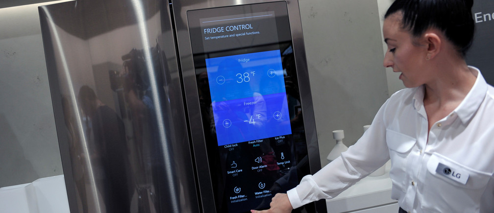 An assistant presents a smart home refridgerator by LG at the IFA Electronics show in Berlin, Germany September 2, 2016. REUTERS/Stefanie Loos - D1BETYYZHZAB