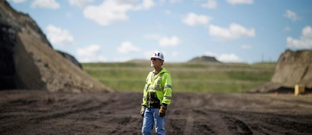 Kevin Officer, the production team leader at Rawhide mine stands in one of the active, open mine pits during a tour of Peabody Energy's Rawhide coal mine near Gillette, Wyoming, U.S. June 1, 2016. Officer has been with Peabody Energy for 38 years. The company filed for Chapter 11 bankruptcy in April.  REUTERS/Kristina Barker
