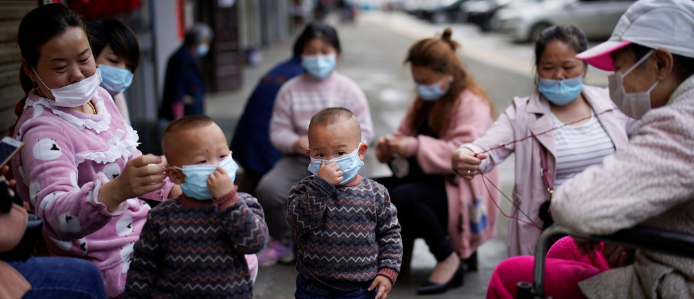 Children and women wearing face masks are seen in Xianning, after the lockdown was eased in Hubei province, the epicentre of China's coronavirus disease (COVID-19) outbreak, March 26, 2020. Coronavirus china virus health healthcare who world health organization disease deaths pandemic epidemic worries concerns Health virus contagious contagion viruses diseases disease lab laboratory doctor health dr nurse medical medicine drugs vaccines vaccinations inoculations technology testing test medicinal biotechnology biotech biology chemistry physics microscope research influenza flu cold common cold bug risk symptomes respiratory china iran italy europe asia america south america north washing hands wash hands coughs sneezes spread spreading precaution precautions health warning covid 19 cov SARS 2019ncov wuhan sarscow wuhanpneumonia  pneumonia outbreak patients unhealthy fatality mortality elderly old elder age serious death deathly deadly
