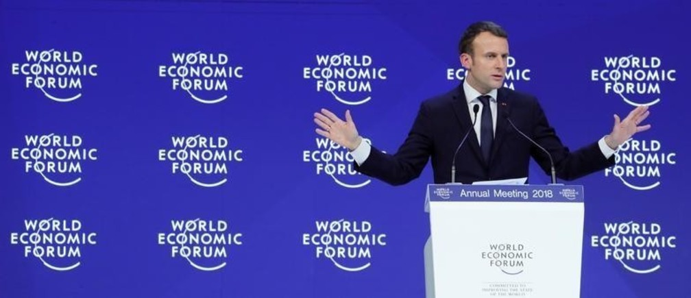 France's President Emmanuel Macron gestures as he speaks during the World Economic Forum (WEF) annual meeting in Davos, Switzerland January 24, 2018.  REUTERS/Denis Balibouse - RC14373B8800