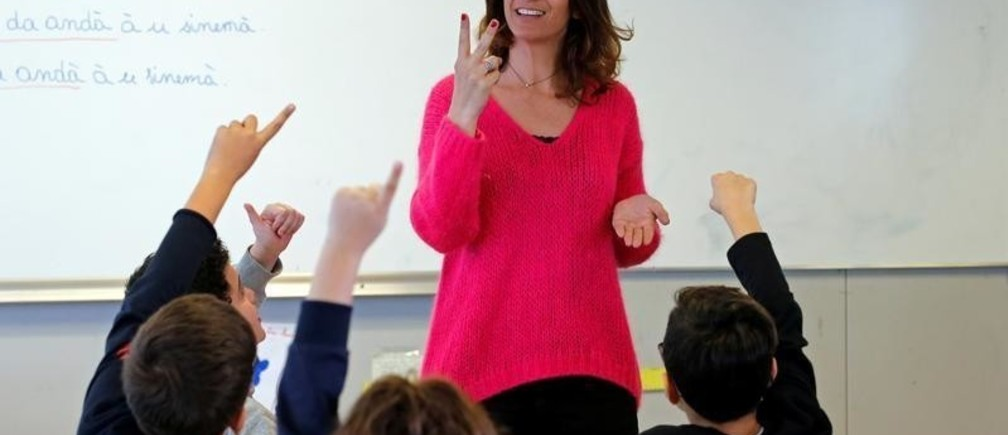 Nathalie Lanfranchi, primary school teacher, teaches the Corsican language to schoolchildren in the outskirts of Ajaccio on the French Mediterranean island of Corsica, January 30, 2018. Picture taken January 30, 2018.   REUTERS/Jean-Paul Pelissier - RC1F0305CBA0
