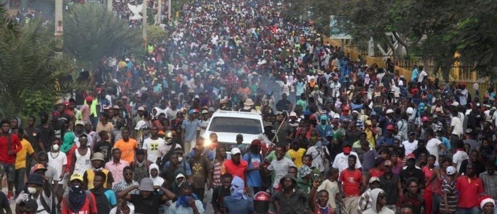 Demonstrators participate in an anti-government protest in Port-au-Prince, Haiti, February 12, 2019. REUTERS/Jeanty Junior Augustin - RC1A5C07F650