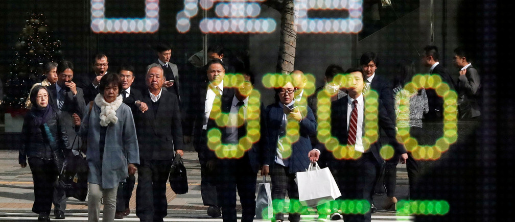 People are reflected in a stock quotation board showing share price of Nissan Motor Co outside a brokerage in Tokyo, Japan November 20, 2018.   REUTERS/Toru Hanai - RC1F5F10C830