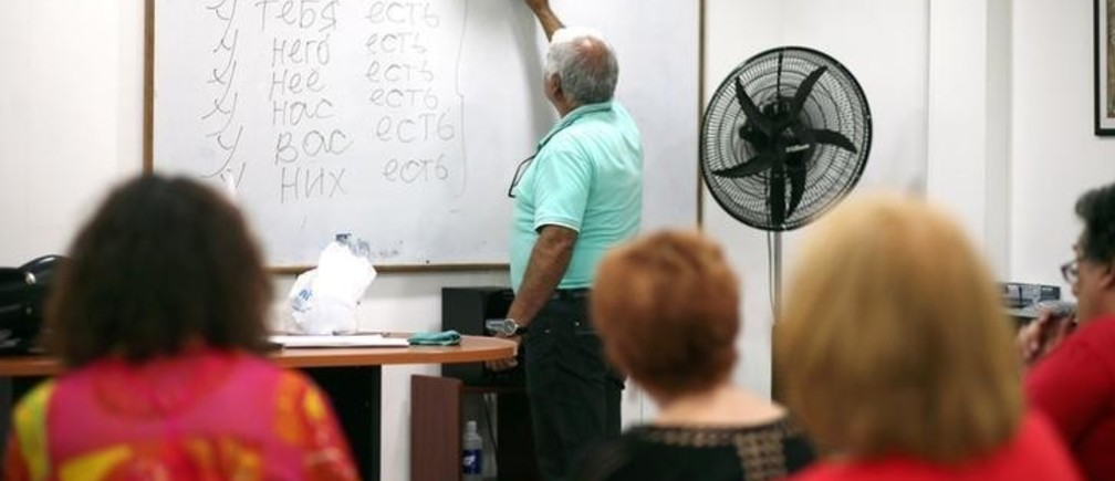 Teacher Blas Dimir Villalba writes on the board as Russian language students attend class in Buenos Aires, Argentina, March 6, 2018. Picture taken March 6, 2018. REUTERS/Marcos Brindicci