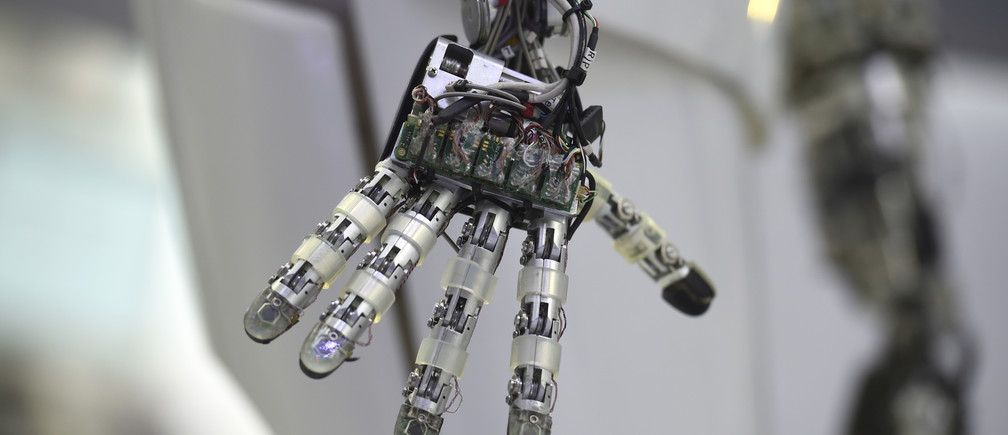 A hand of a robot is seen at the Robotics Innovation Center booth during preparations at the CeBit computer, which will open its doors to the public on March 20, at the fairground in Hanover, Germany, March 19, 2017.   REUTERS/Fabian Bimmer  - LR1ED3K0Q64ZJ
