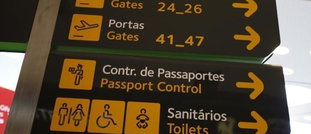 Gates, passport control and toilets signs are seen at Lisbon's airport, Portugal June 24, 2016. REUTERS/Rafael Marchante