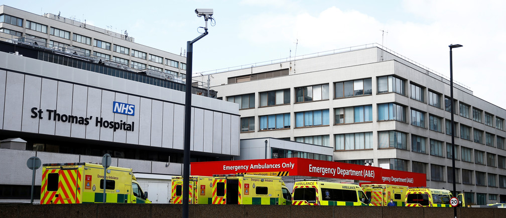 Ambulances are seen outside St Thomas' hospital, as the spread of the coronavirus disease (COVID-19) continues, London, Britain, March 29, 2020. REUTERS/Henry Nicholls - RC2QTF97DLS8