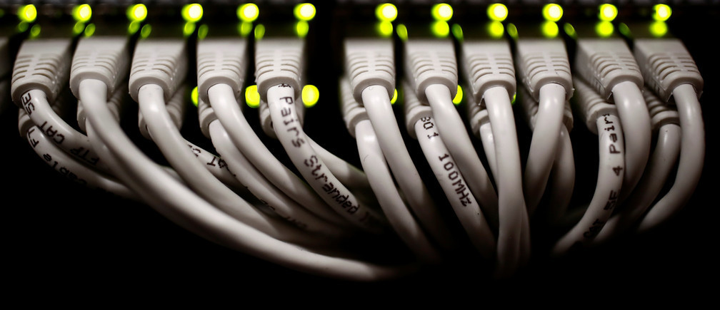 RJ45 cables are pictured inside the data centre operated by French telecoms operator Iliad in Paris, France, March 4, 2019. REUTERS/Christian Hartmann - RC13968AEFE0