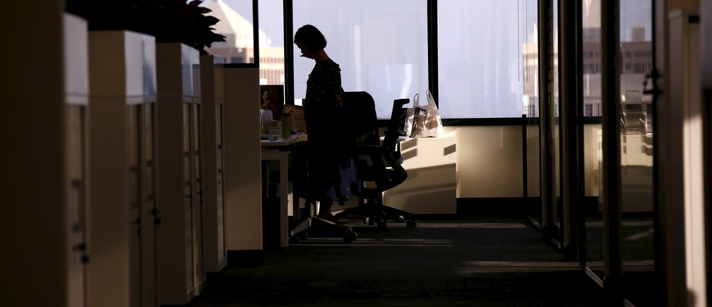 An employee of software company Nuix stands in their office located in central Sydney, Australia, April 5, 2016