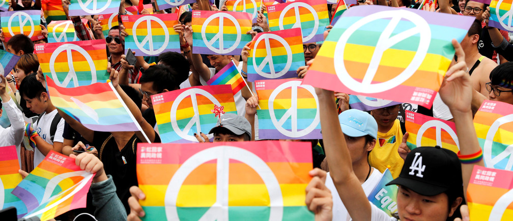 Same-sex marriage supporters take part in a lesbian, gay, bisexual and transgender (LGBT) pride parade after losing in the marriage equality referendum in Taiwan, November 2018.