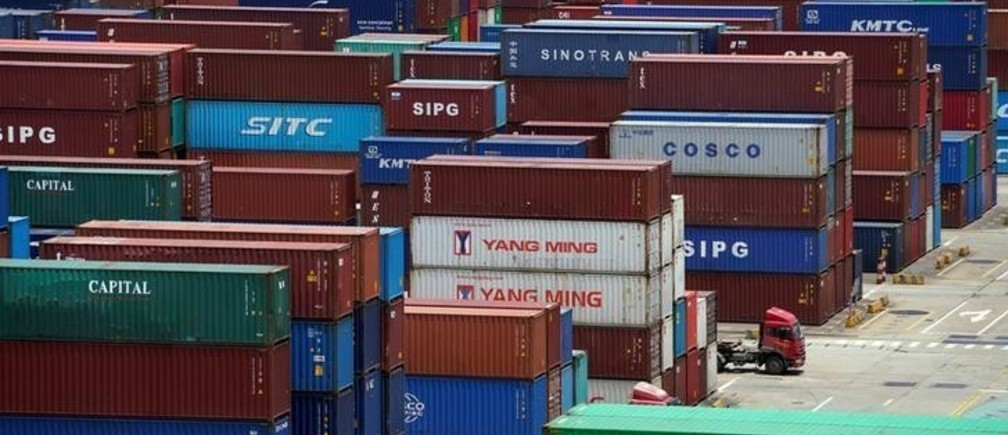 Shipping containers are seen at a port in Shanghai, China July 10, 2018. REUTERS/Aly Song