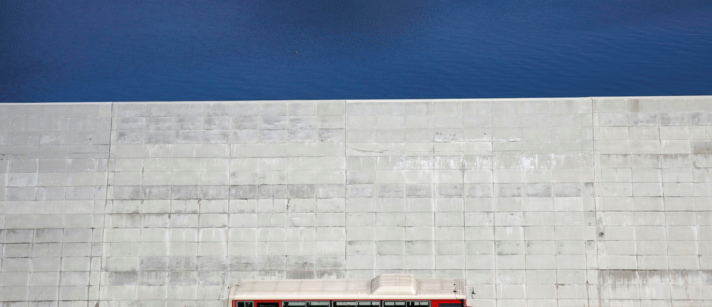 A bus is driven past a seawall in Yamada village, Iwate Prefecture, Japan, March 3, 2018