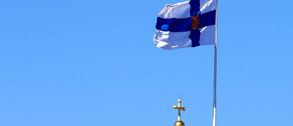 Finland's presidential standard flutters over his residence in Helsinki, Finland, May 3, 2017. REUTERS/Ints Kalnins - RTS151LL
